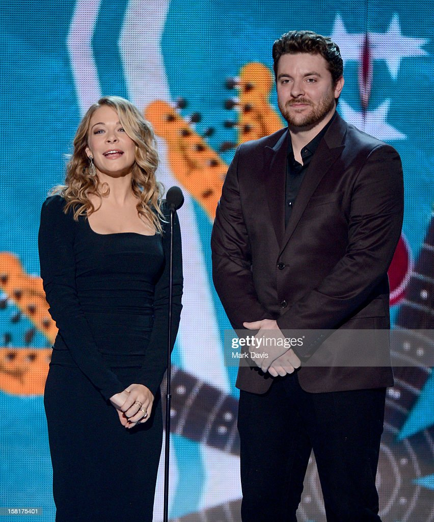 Presenters LeAnn Rimes and <a gi-track='captionPersonalityLinkClicked' href=/galleries/search?phrase=Chris+Young&family=editorial&specificpeople=221447 ng-click='$event.stopPropagation()'>Chris Young</a> speak onstage during the 2012 American Country Awards at the Mandalay Bay Events Center on December 10, 2012 in Las Vegas, Nevada.