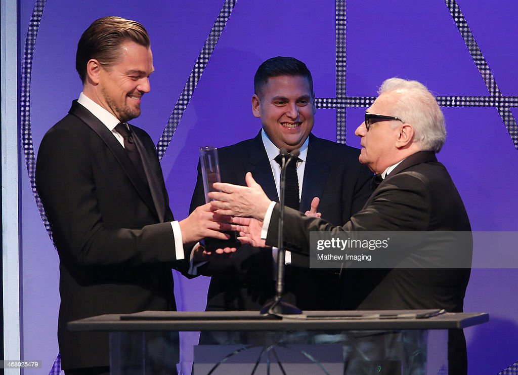 Presenters <a gi-track='captionPersonalityLinkClicked' href=/galleries/search?phrase=Leonardo+DiCaprio&family=editorial&specificpeople=201635 ng-click='$event.stopPropagation()'>Leonardo DiCaprio</a>, <a gi-track='captionPersonalityLinkClicked' href=/galleries/search?phrase=Jonah+Hill&family=editorial&specificpeople=544481 ng-click='$event.stopPropagation()'>Jonah Hill</a> and Cinematic Imagery Award Honoree <a gi-track='captionPersonalityLinkClicked' href=/galleries/search?phrase=Martin+Scorsese&family=editorial&specificpeople=201976 ng-click='$event.stopPropagation()'>Martin Scorsese</a> at the 18th Annual ADG Awards held at The Beverly Hilton Hotel on February 8, 2014 in Beverly Hills, California.
