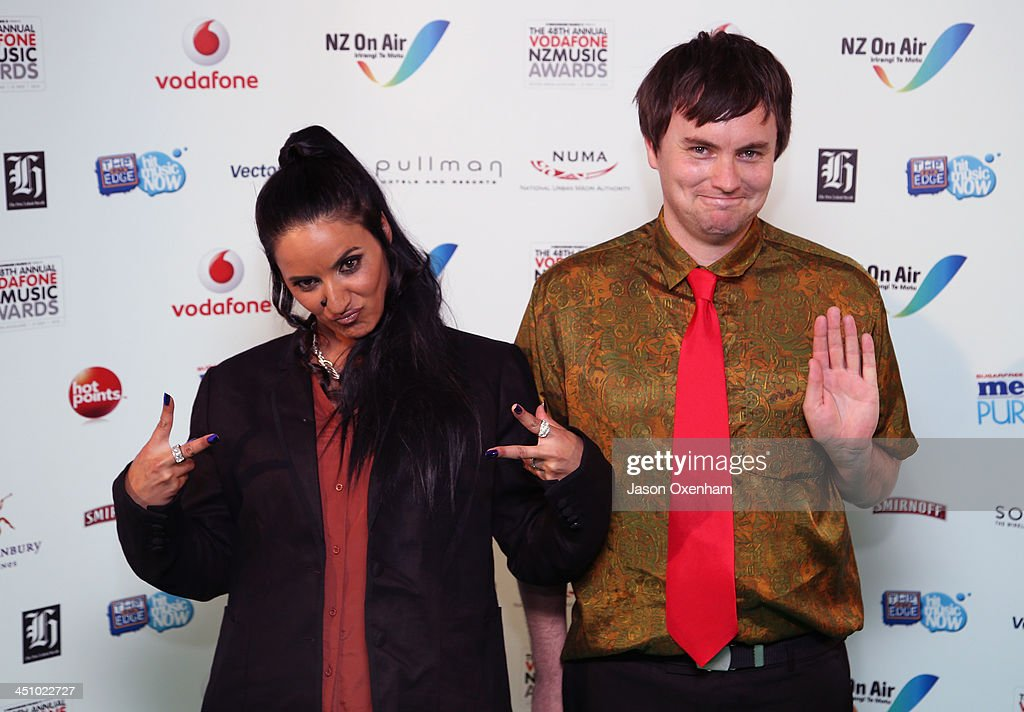 Presenters Madeleine Sami(L) and Thomas Sainsbury poses during the New Zealand Music Awards at the Vector Arena on November 21, 2013 in Auckland, New Zealand.