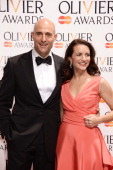 Presenters Mark Strong and Kristin Davis pose in the press room at the Laurence Olivier Awards at The Royal Opera House on April 13 2014 in London...