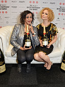 Presenters Meera Syal and MyAnna Buring pose at The Moet British Independent Film Awards 2014 at Old Billingsgate Market on December 7 2014 in London...
