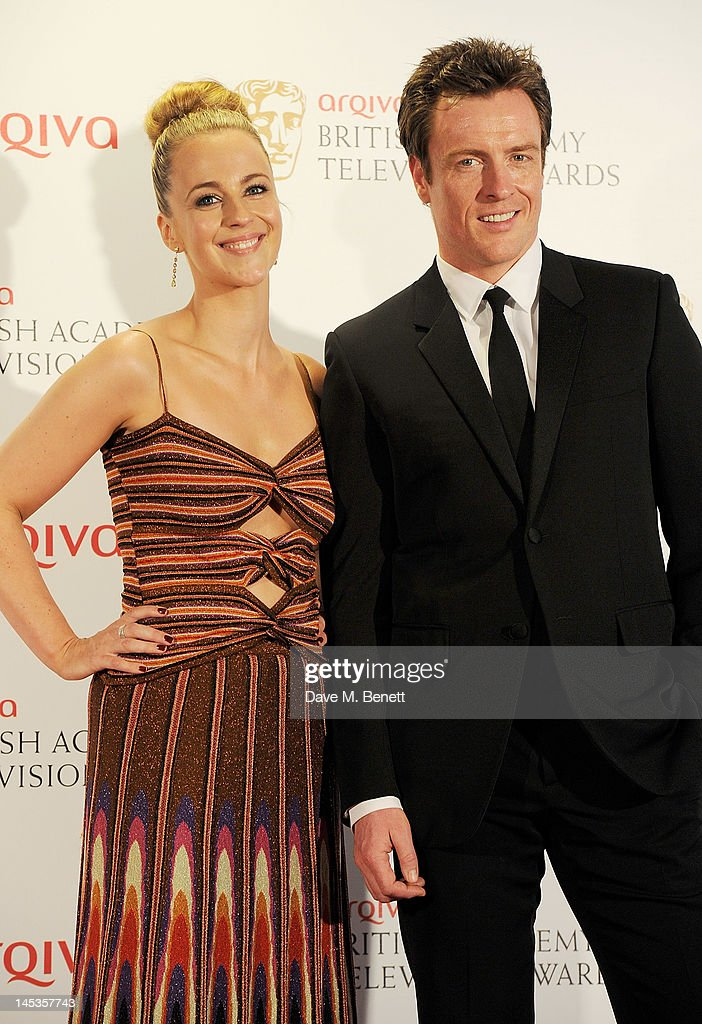 Presenters Miranda Raison (L) and <a gi-track='captionPersonalityLinkClicked' href=/galleries/search?phrase=Toby+Stephens&family=editorial&specificpeople=806801 ng-click='$event.stopPropagation()'>Toby Stephens</a> pose in front of the winners boards at the Arqiva British Academy Television Awards 2012 held at Royal Festival Hall on May 27, 2012 in London, England.