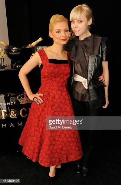 Presenters MyAnna Buring and Antonia CampbellHughes pose backstage at the Moet British Independent Film Awards 2013 at Old Billingsgate Market on...
