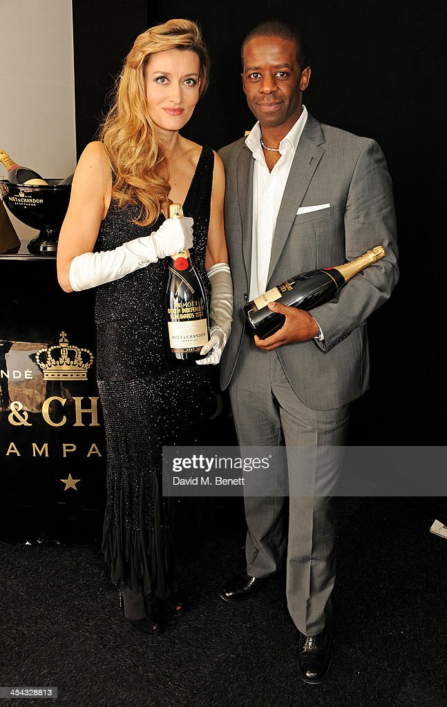 Presenters Natascha McElhone (L) and Adrian Lester pose backstage at the Moet British Independent Film Awards 2013 at Old Billingsgate Market on December 8, 2013 in London, England.