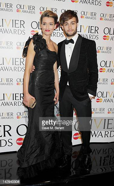 Presenters Natascha McElhone and Douglas Booth pose in the press room at the 2012 Olivier Awards held at The Royal Opera House on April 15 2012 in...