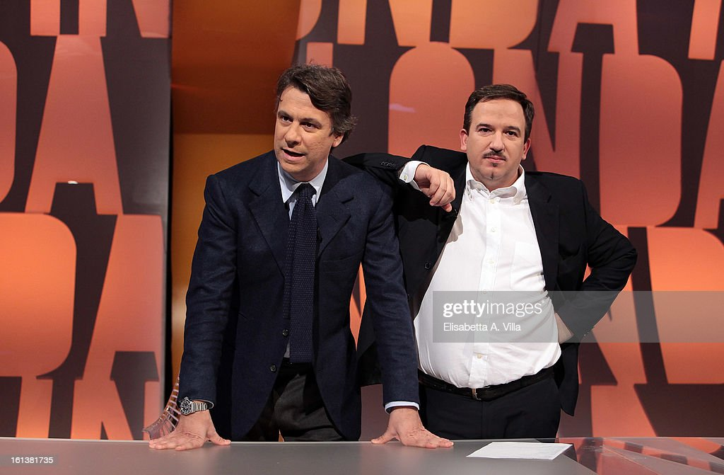 TV presenters Nicola Porro (L) and <a gi-track='captionPersonalityLinkClicked' href=/galleries/search?phrase=Luca+Telese&family=editorial&specificpeople=7072224 ng-click='$event.stopPropagation()'>Luca Telese</a> pose on set of Italian TV talk-show 'In Onda' on February 10, 2013 in Rome, Italy.