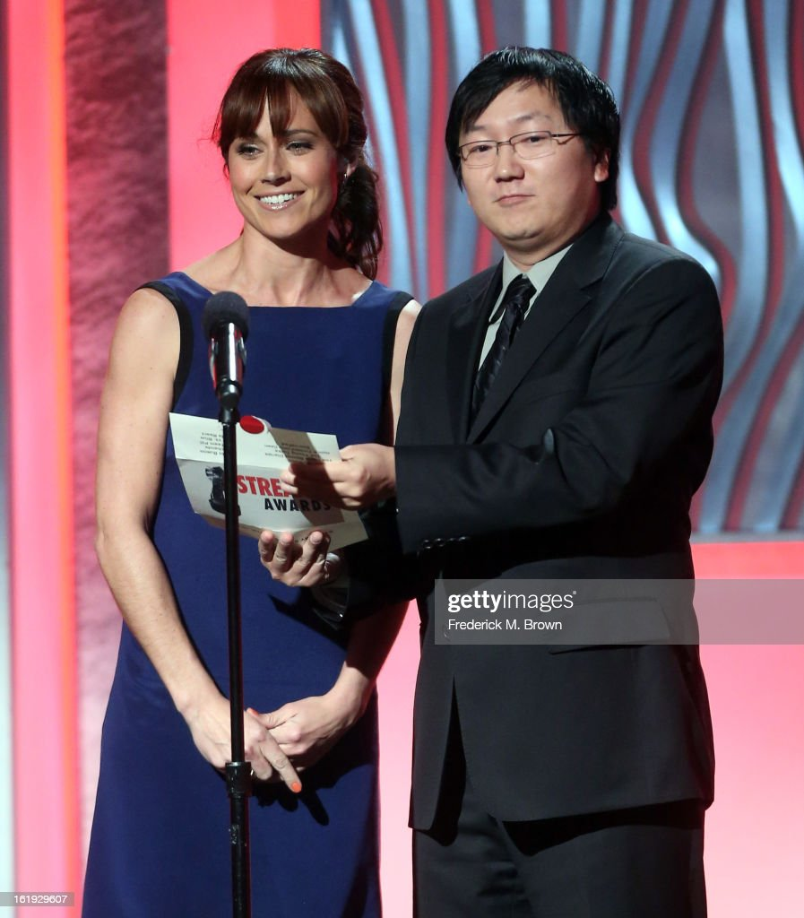 Presenters <a gi-track='captionPersonalityLinkClicked' href=/galleries/search?phrase=Nikki+DeLoach&family=editorial&specificpeople=762634 ng-click='$event.stopPropagation()'>Nikki DeLoach</a> and <a gi-track='captionPersonalityLinkClicked' href=/galleries/search?phrase=Masi+Oka&family=editorial&specificpeople=744993 ng-click='$event.stopPropagation()'>Masi Oka</a> speak onstage at the 3rd Annual Streamy Awards at Hollywood Palladium on February 17, 2013 in Hollywood, California.