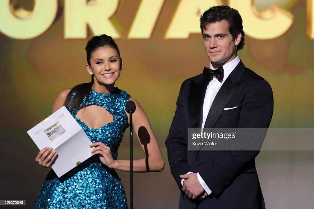 Presenters Nina Dobrev (L) and Henry Cavill speak onstage at the 18th Annual Critics' Choice Movie Awards held at Barker Hangar on January 10, 2013 in Santa Monica, California.