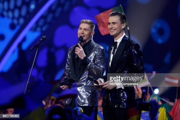 Presenters Oleksandr Skichko and Volodymyr Ostapchuk speak on stage during the final of the 62nd Eurovision Song Contest at International Exhibition...