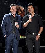 Presenters Oscar De La Hoya and iHeartRadio Personality Mario Lopez speak onstage during the iHeartRadio Fiesta Latina festival presented by Sprint...