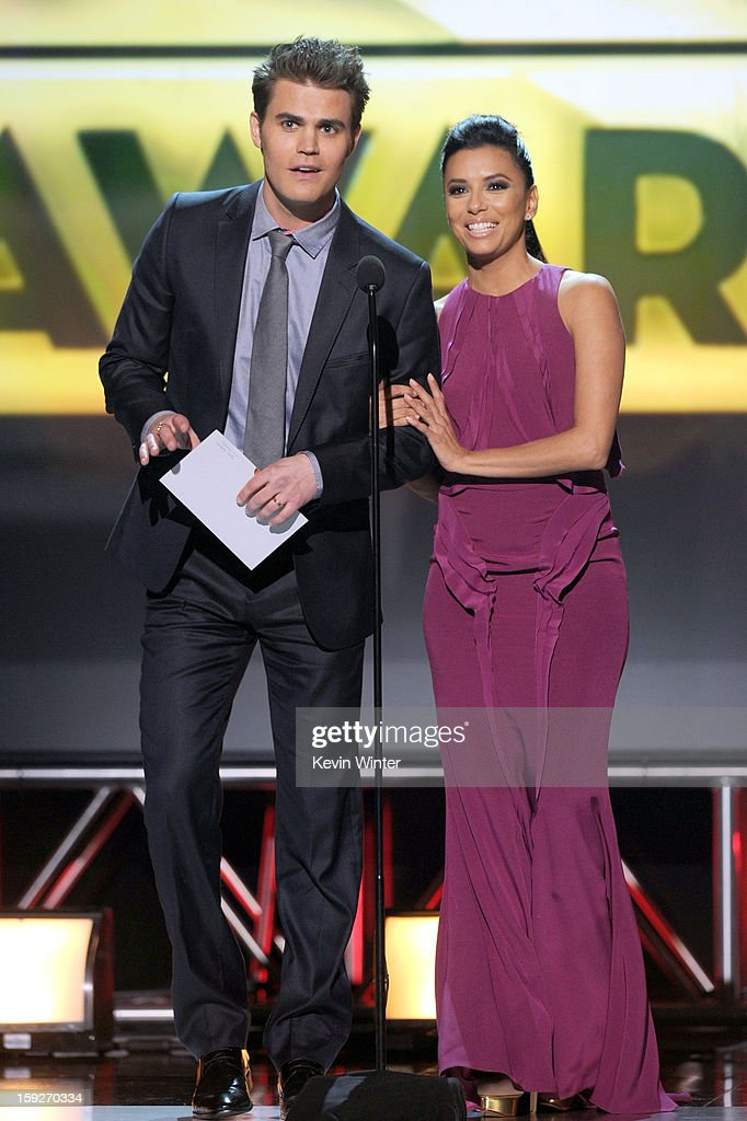 Presenters Paul Wesley (L) and Eva Longoria speak onstage at the 18th Annual Critics' Choice Movie Awards held at Barker Hangar on January 10, 2013 in Santa Monica, California.