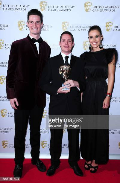 Presenters Peter Wilson and Charlie Webster present Dan Holman with the Sport award for FIFA 14 at the British Academy Games Awards at Tobacco Dock...
