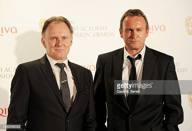 Presenters Philip and Robert Glenister pose in front of the winners boards at the Arqiva British Academy Television Awards 2012 held at Royal...