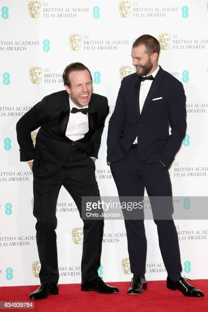 Presenters Rafe Spall and Jamie Dornan pose in the winners room during the 70th EE British Academy Film Awards at Royal Albert Hall on February 12...