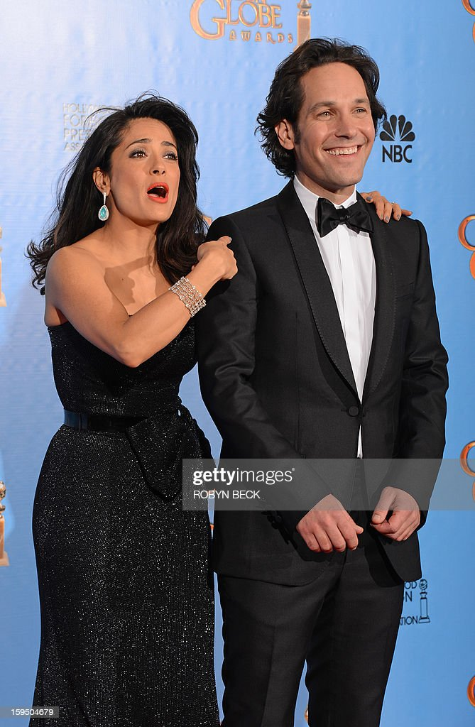 Presenters Salma Hayek and Paul Rudd pose in the press room during the 70th Annual Golden Globe Awards held at The Beverly Hilton Hotel on January 13, 2013 in Beverly Hills, California. AFP PHOTO/Robyn BECK