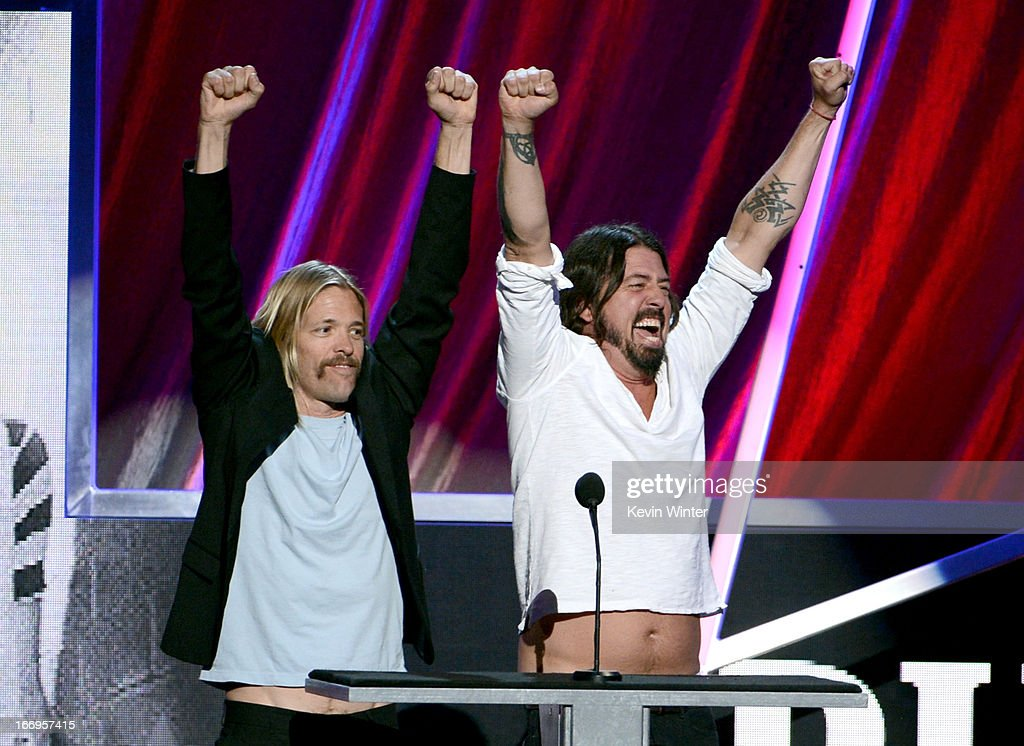 Presenters Taylor Hawkins and Dave Grohl of Foo Fighters speak onstage at the 28th Annual Rock and Roll Hall of Fame Induction Ceremony at Nokia Theatre L.A. Live on April 18, 2013 in Los Angeles, California.