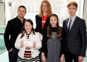 Presenters Warren Brown and Luke Newberry with winners Erin Stott Joe Goff and Erin Richardson attend the First Light Awards at Odeon Leicester...