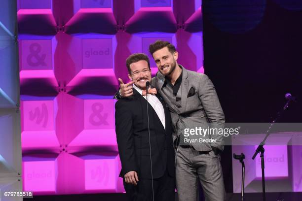 Presenters Zeke Smith and Nico Tortorella speak on stage at the 28th Annual GLAAD Media Awards at The Hilton Midtown on May 6 2017 in New York City