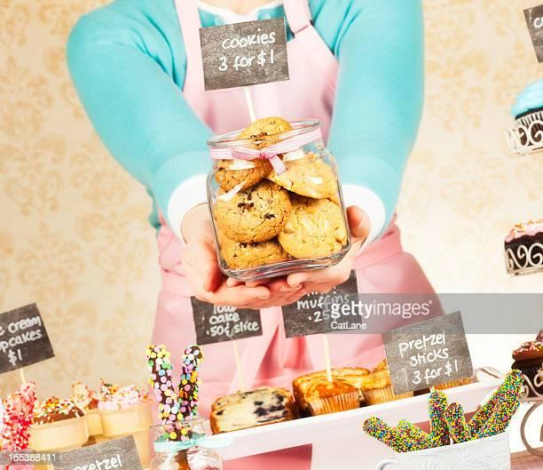 Presenting Cookies at Bake Sale Fundraiser