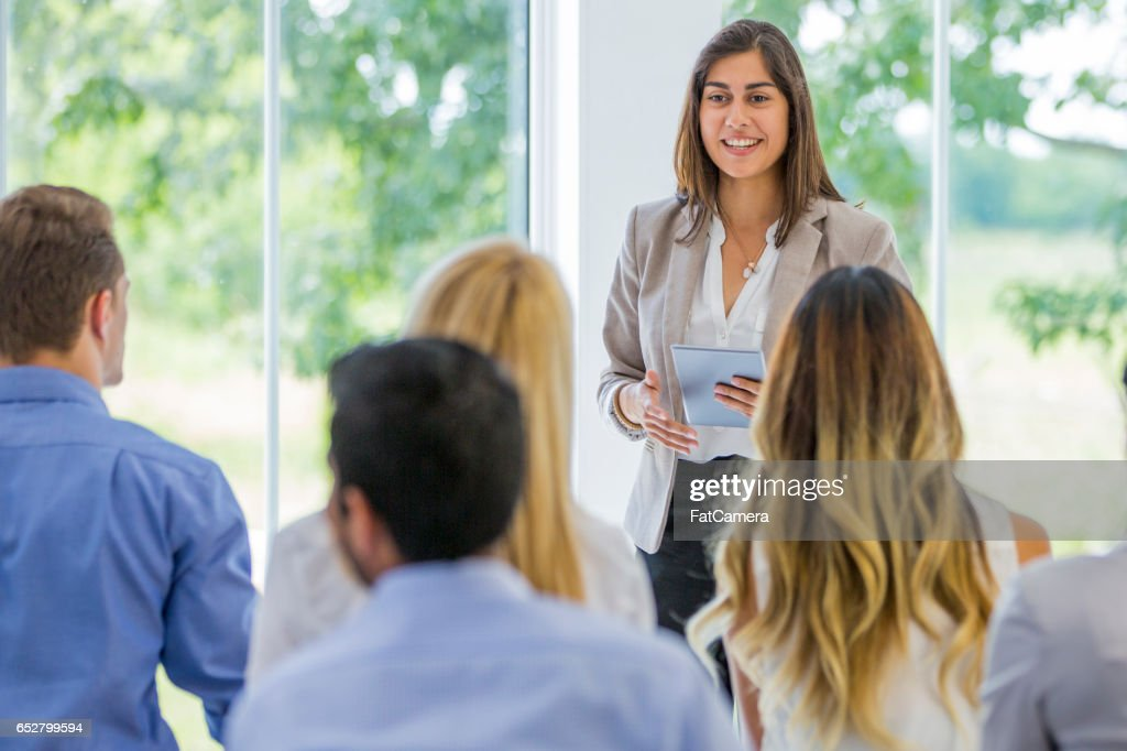 Presenting to a Group of Coworkers : Stock Photo