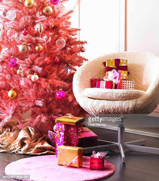 Presents in armchair by Christmas tree