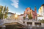 Romantic Ljubljana's city center: river Ljubljanica, Triple Bridge, Tromostovje, Preseren square and Franciscan Church of the Annunciation. Ljubljana, Slovenia, Europe.