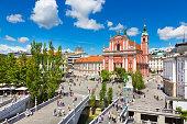 Romantic Ljubljana city center: river Ljubljanica, Triple Bridge (Tromostovje), Preseren square and Franciscan Church of the Annunciation; Ljubljana, Slovenia, Europe.