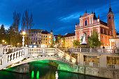 Romantic Ljubljana's city center at dusk. River Ljubljanica, Triple Bridge, Preseren square and Franciscan Church of the Annunciation. Ljubljana, Slovenia, Europe.