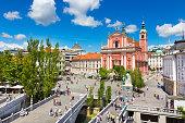 Romantic Ljubljana city center. River Ljubljanica, Triple Bridge - Tromostovje, Preseren square and Franciscan Church of the Annunciation. Ljubljana Slovenia Europe.