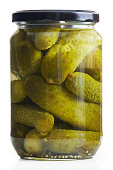 Jar of pickled cucumbers isolated on white background