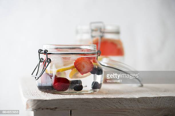 Preserving jar of cooled water flavoured with different fruits