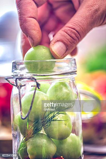 Preserving Organic Carrots Green Tomatoes in a Jar