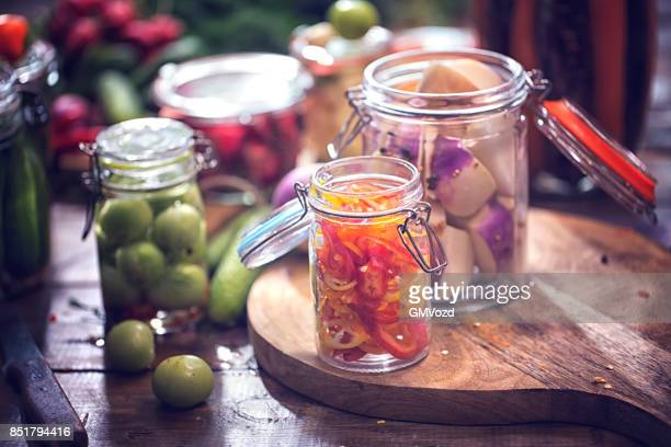Preserving Organic Green Tomatoes, Paprika and Radishes in Jars