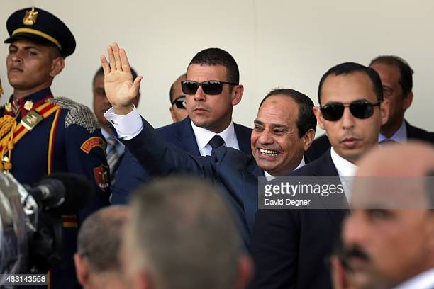President Abdel Fattah elSisi walks during the opening ceremony of the new Suez Canal expansion including a new 35km channel on August 6 2015 in Suez...