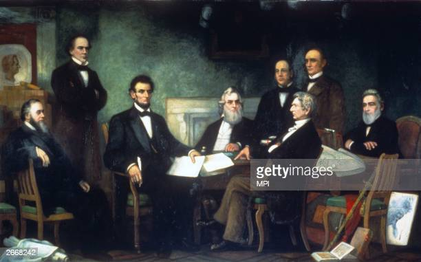 President Abraham Lincoln reading the Emancipation Proclamation which declared that all slaves in rebelheld territory would be 'thenceforward and...