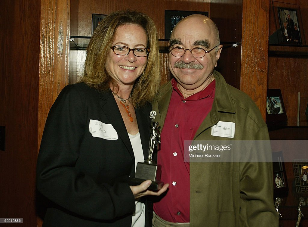 President, A.C.E. Alan Deim hands editor Sally Menke the nomination for Best Edite Feature Film (Dramatic) for 'Kill Bill: Volume 2' at the nominee reception for the American Cinema Editors Eddie Awards on February 17, 2005 at the Kodak Atrium in Hollywood, California.