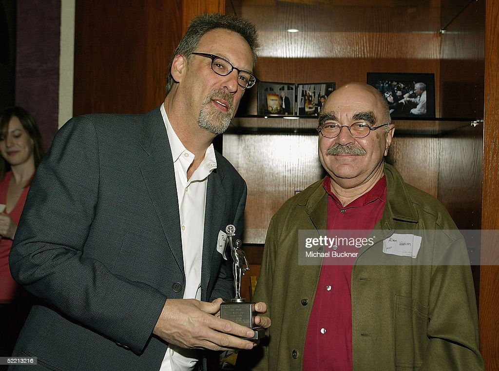 President, A.C.E. Alan Heim hands editor Paul Dixon the nominee for Best Edited Miniseries or Motion Picture for Commercial Television for 'The Wool Cap' at the nominee reception for the American Cinema Editors Eddie Awards on February 17, 2005 at the Kodak Atrium in Hollywood, California.
