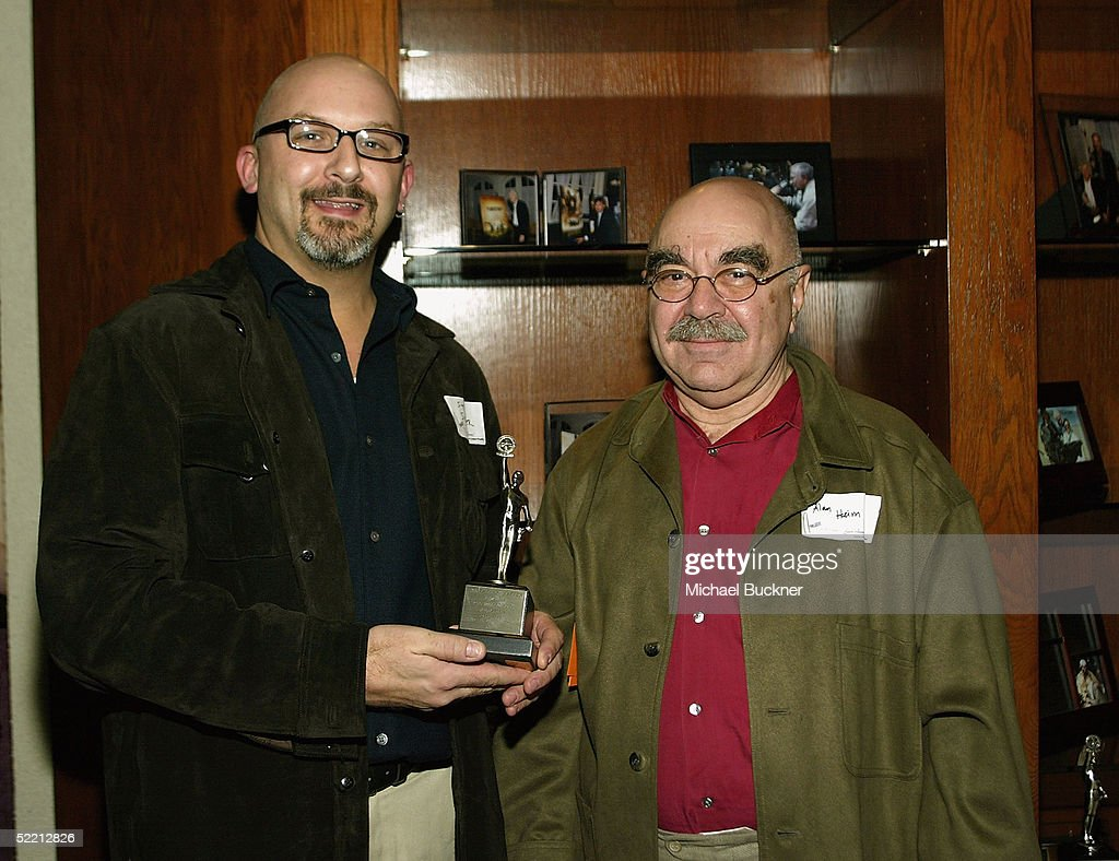 President, A.C.E. Alan Heim hands editor Stephen Schaffer the nomination for 'Best Edited Feature Film (Comedy or Musical) for 'The Incredibles' at the nominee reception for the American Cinema Editors Eddie Awards on February 17, 2005 at the Kodak Atrium in Hollywood, California.