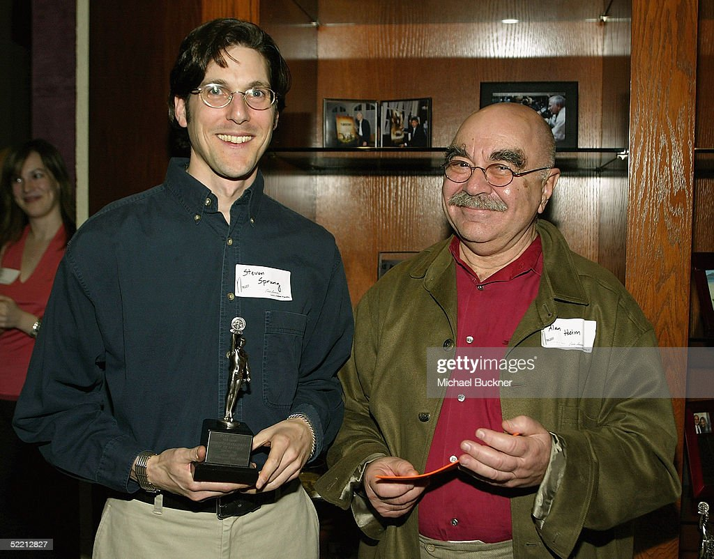 President, A.C.E. Alan Heim hands editor Steven Sprung the nomination for Best Edited Half-Hour Series for Television for 'Arrested Development: 'Let' em Eat Cake' at the nominee reception for the American Cinema Editors Eddie Awards on February 17, 2005 at the Kodak Atrium in Hollywood, California.
