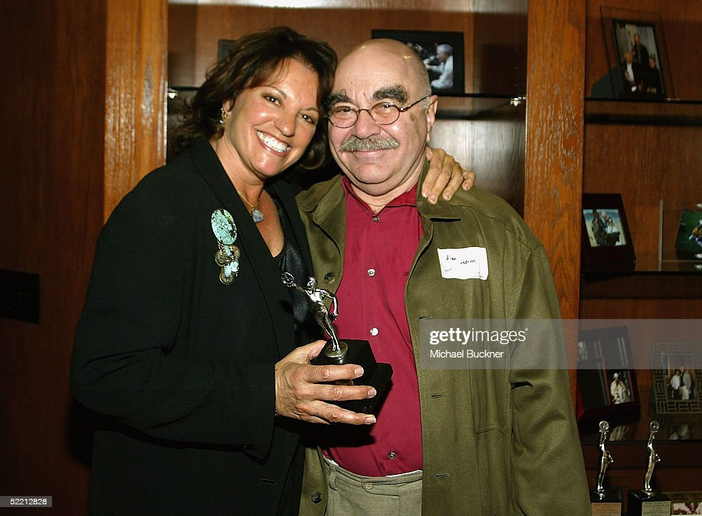 President, A.C.E. Alan Heim hands editor Virginia Katz the nomination for Best Edited Feature Film (Dramatic) for 'Kinsey' at the nominee reception for the American Cinema Editors Eddie Awards on February 17, 2005 at the Kodak Atrium in Hollywood, California.