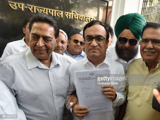 President Ajay Maken with other exMLAs coming out of LG house after meeting with LG Anil Baijal over Delhi Chief Minister Arvind Kejriwal's issue on...