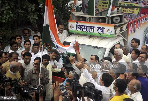 President Ajay Maken with Sr Congress Leader Sajjan Kumar and other congress leaders during the launch of Kisan Rath campaign to start an awareness...