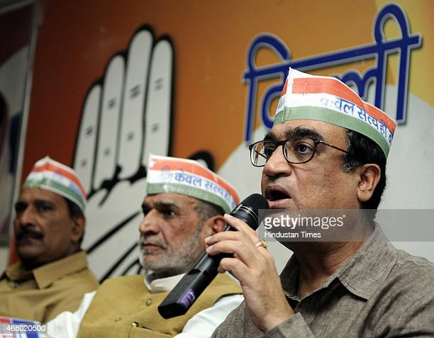 President Ajay Maken with Sr Congress Leader Sajjan Kumar and other congress leaders addressing media person after launching Kisan Rath campaign to...