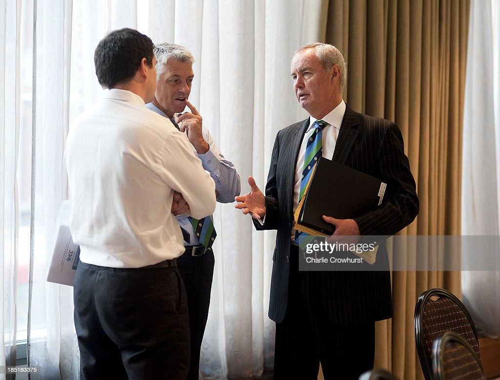 President Alan Isaac chats with Cheif Executive David Richardson during the ICC Board Meeting at The Royal Garden Hotel on October 18, 2013 in London, England.