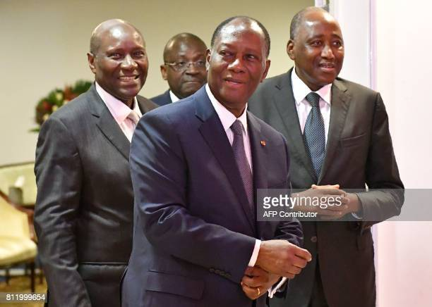 President Alassane Ouattara of Côte d'Ivoire Vice President Daniel Kablan Duncan and Prime Minister Amadou Gon Coulibaly leave after a meeting with...