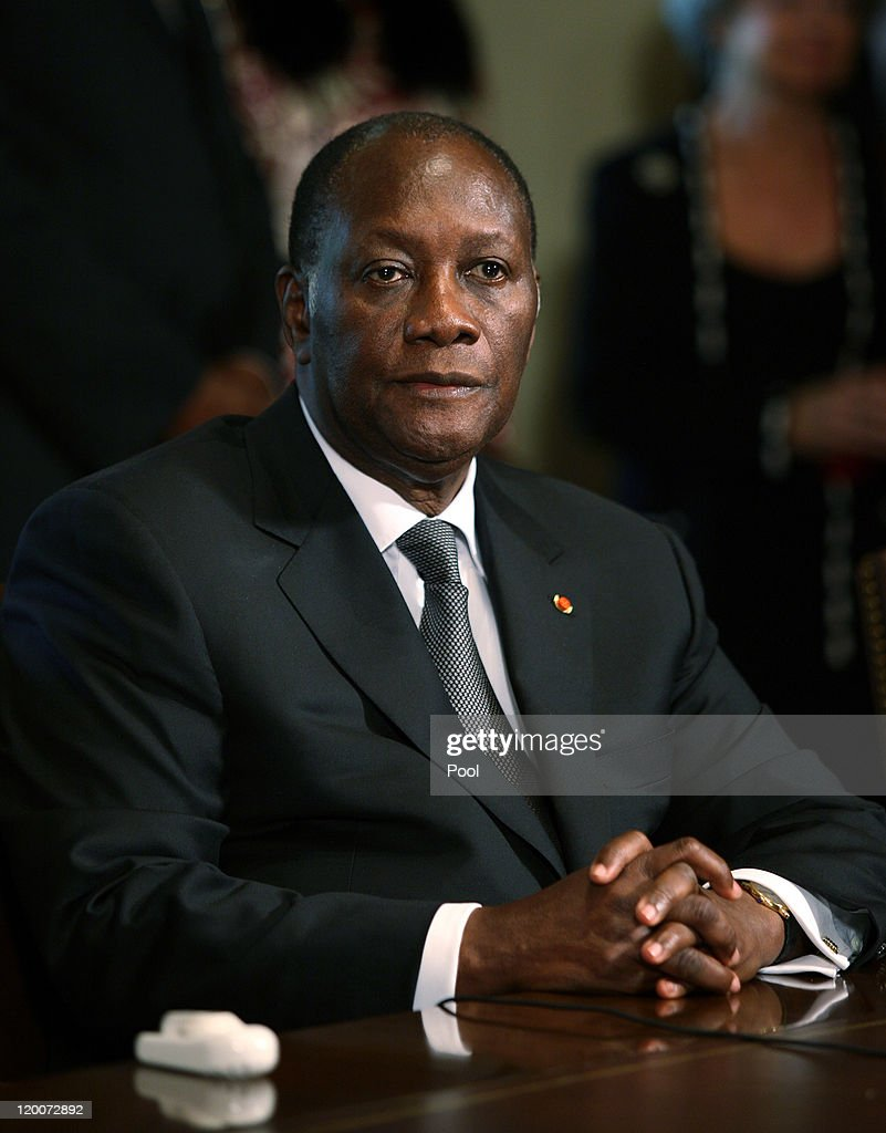 President Alassane Ouattara of the Ivory Coast sits during meeting with US President Barack Obama and other African leaders in the Cabinet Room of...