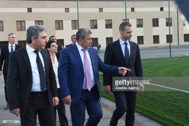President Aleksander Ceferin and Football Federation of Armenia President Ruben Hayrapetyan talk to each other after the groundbreaking ceremony of...