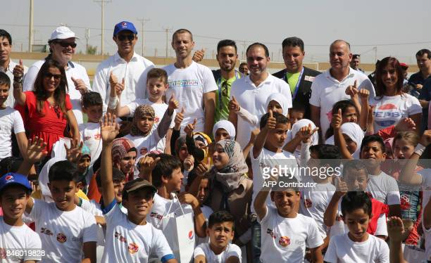 President Aleksander Ceferin and Jordan's Prince Ali bin alHussein pose for a family picture with Syrian refugee children during the opening ceremony...