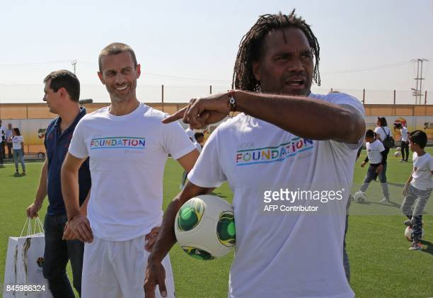 President Aleksander Ceferin and retired French football Christian Karembeu attend the opening ceremony of a football field at the Zaatari refugee...