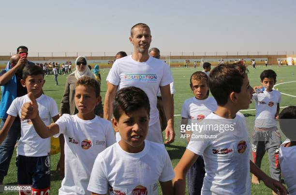 President Aleksander Ceferin attends the opening ceremony of a football field at the Zaatari refugee camp 80 kilometers north of the capital Amman on...